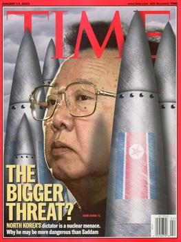 金正日とミサイル.jpg