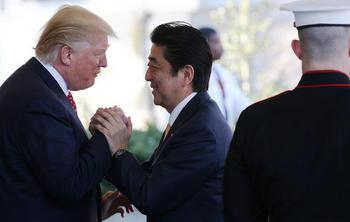 20170216-abe-trump-shake-hands-getty_article_main_image.jpg